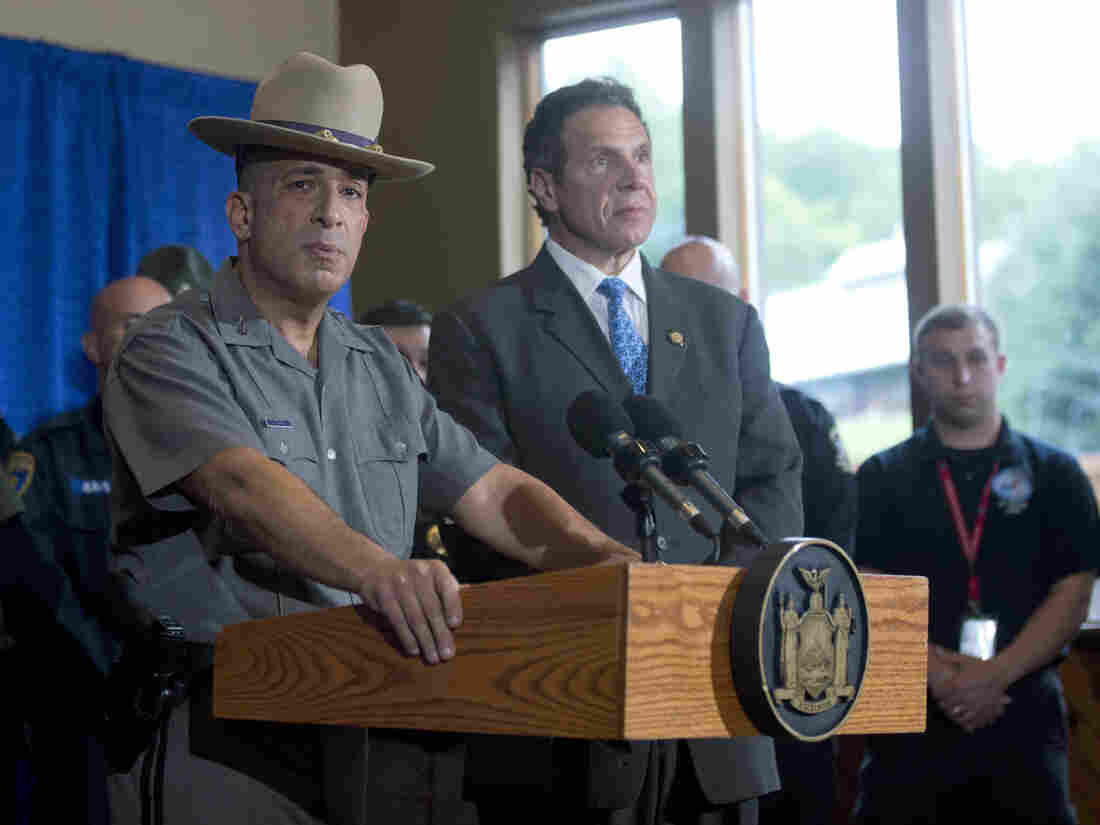 New York State Police Superintendent Joseph D'Amico (left) speaks during a news conference Sunday evening as Gov. Andrew Cuomo looks on. At the press conference, both men detailed the capture of fugitive David Sweat earlier that day in Malone, N.Y.
