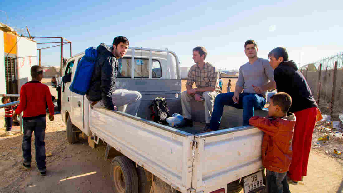 American filmmakers Zach Ingrasci, left, and Chris Temple, in plaid shirt, received permission from the United Nations to spend a month with Syrian refugees at the Zaatari camp in Jordan.
