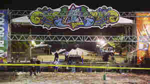 Police investigators inspect the stage area after an explosion during a music concert at the Formosa Water Park in New Taipei City, Taiwan, on June 28.