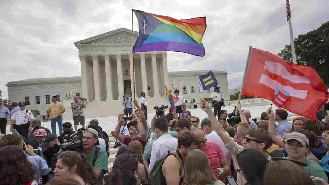 The crowd reacts as the ruling on same-sex marriage was announced outside of the Supreme Court in Washington, D.C., Friday.