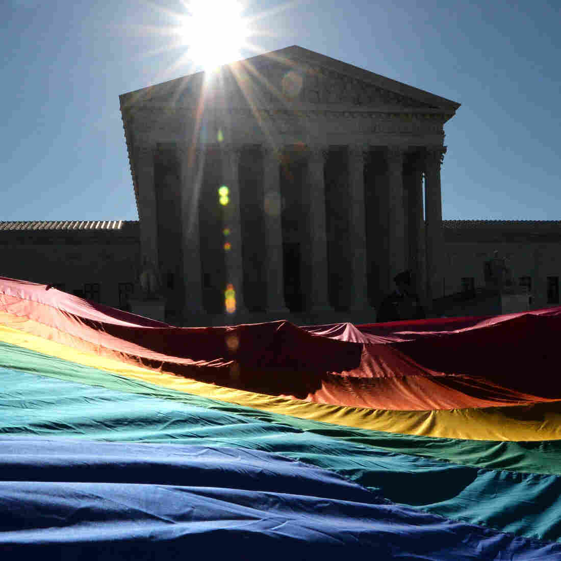 Supporters of same-sex marriages gather outside the U.S. Supreme Court on April 28, in Washington, D.C.