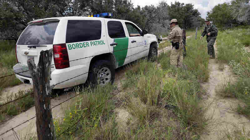 U.S. agents compare notes as they patrol along the Mexico border near McAllen, Texas. A draft report by outside experts calls for steps to confront any claims of corruption in the Border Patrol.