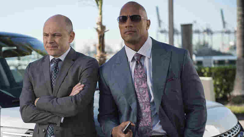 "Dwayne ""The Rock"" Johnson, (right) looks on with Rob Corddry in the HBO series Ballers."