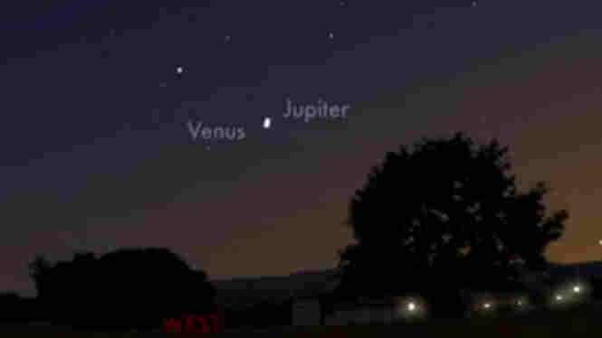 A NASA projection shows the path of Venus and Jupiter; the two planets will converge in the Earth's sky Tuesday night.