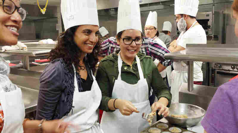 Dr. Geeta Maker-Clark (center) talks to medical students during a culinary medicine class she co-taught with Dr. Sonia Oyola (left) this spring in Chicago. On the right, student Maggie Montoya.
