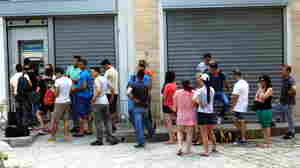 Queues outside an ATM on Sunday June 28 in Litochoro, Greece