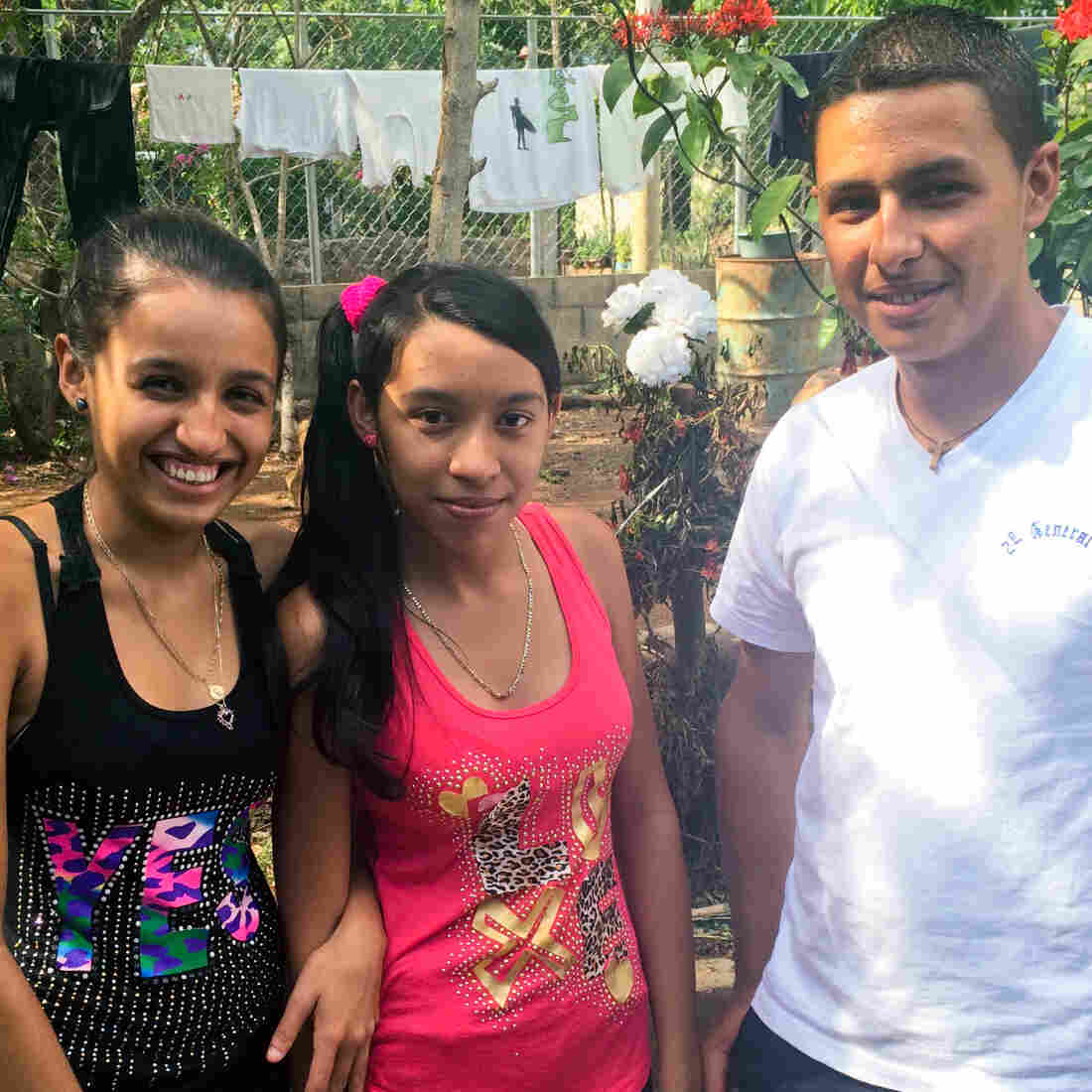Marta Elsie Leveron, 19, (left) and her brother Freddy David Leveron, 18, have not seen their father since he left El Savador to work in California in 1999. A new U.S. program allows families to reunite if one parent is a legal U.S. resident. The girl in the middle is Liliana Beatriz Leveron, 16, a cousin of the other two. Her parents are in the U.S. and she's seeking to reunite with them as well.