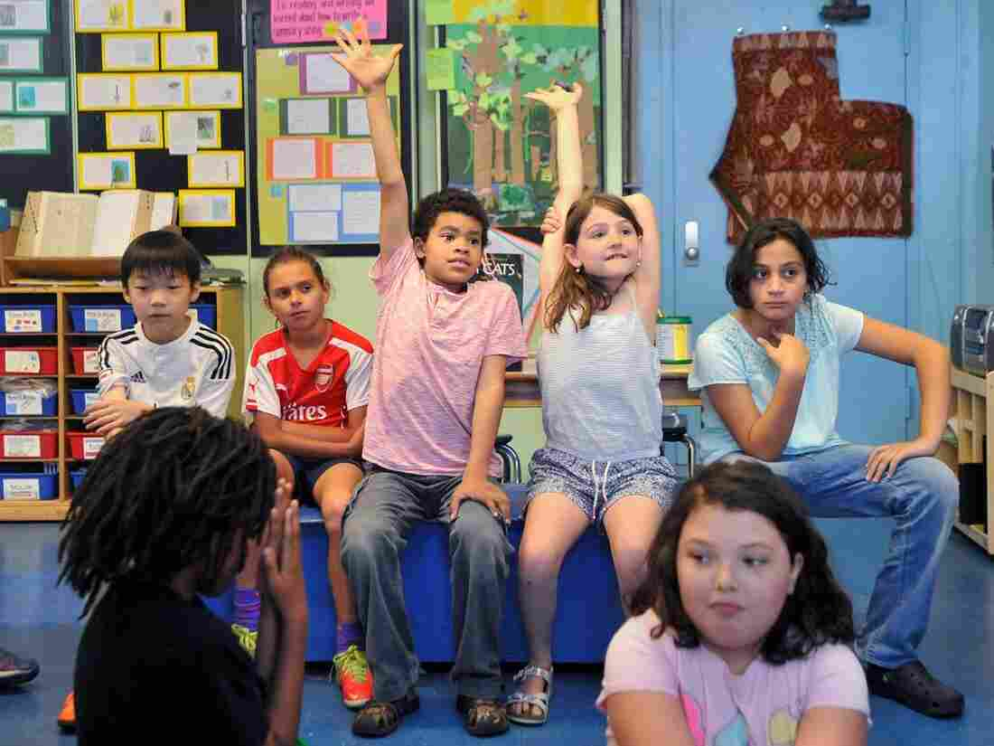 Nine-year-old Q Daily, center, was born a girl, and just finished his first full school year as a boy.