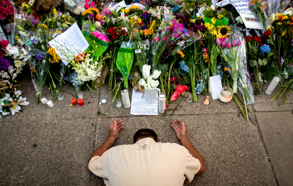 Raymond Smith of Charleston, S.C., kneels in prayer in front of the Emanuel AME Church in Charleston before a worship service on June 21. (Stephen B. Morton/AP)