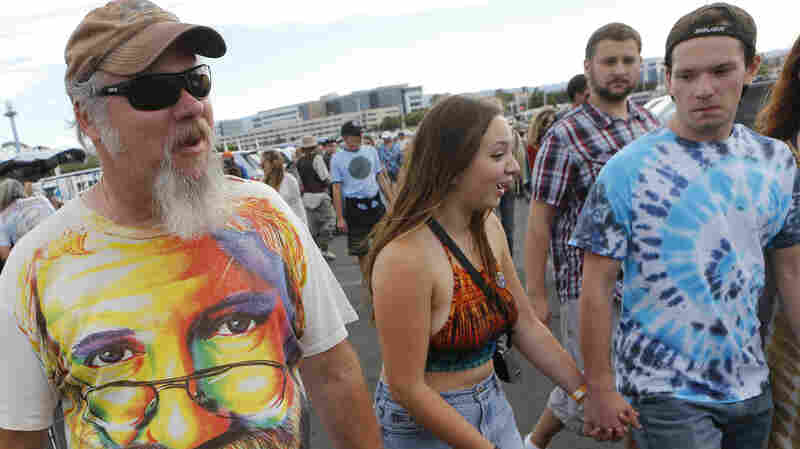 Marc Pierce, 51, of Baker City, Ore., wears a Jerry Garcia T-shirt as he heads to the Grateful Dead concert at Levi's Stadium in Santa Clara, Calif.