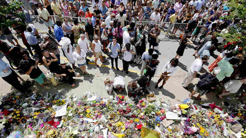 Crowds gather to pay their respects outside Emanuel AME Church in Charleston, S.C., in a photo by the Post and Courier.