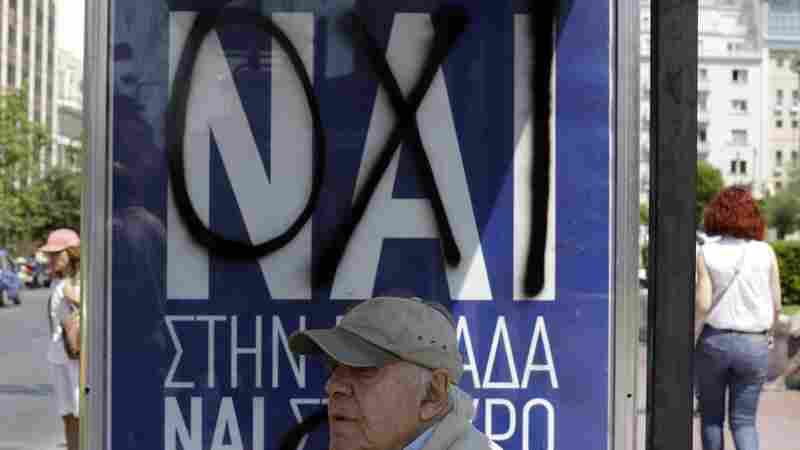 "A man waits at an Athens bus stop where the Greek word ""no"" has been spray-painted over ""yes"" on a banner put up in advance of Sunday's referendum. Greek voters will say whether they want to accept or reject a deal that's been offered by the country's creditors. Greeks are deeply divided and analysts say the outcome is not clear."
