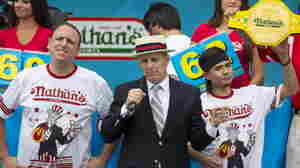 Matt Stonie (right) is crowned winner of the annual Fourth of July Nathan's Famous Hot Dog Eating Contest in Brooklyn, N.Y., Saturday. Stonie defeated eight-time champion Joey Chestnut 62-60.