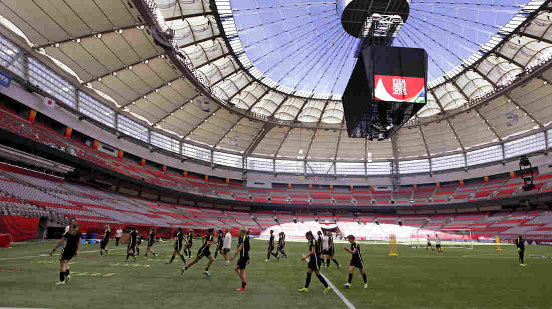 U.S. players run drills during a practice Saturday under the open roof of BC Place in Vancouver, Canada. The U.S. is scheduled to play Japan on Sunday.