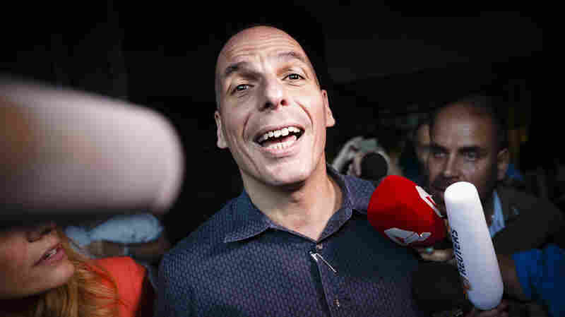 Greek Finance Minister Yanis Varoufakis speaks to the assembled media as he leaves his office in Athens.