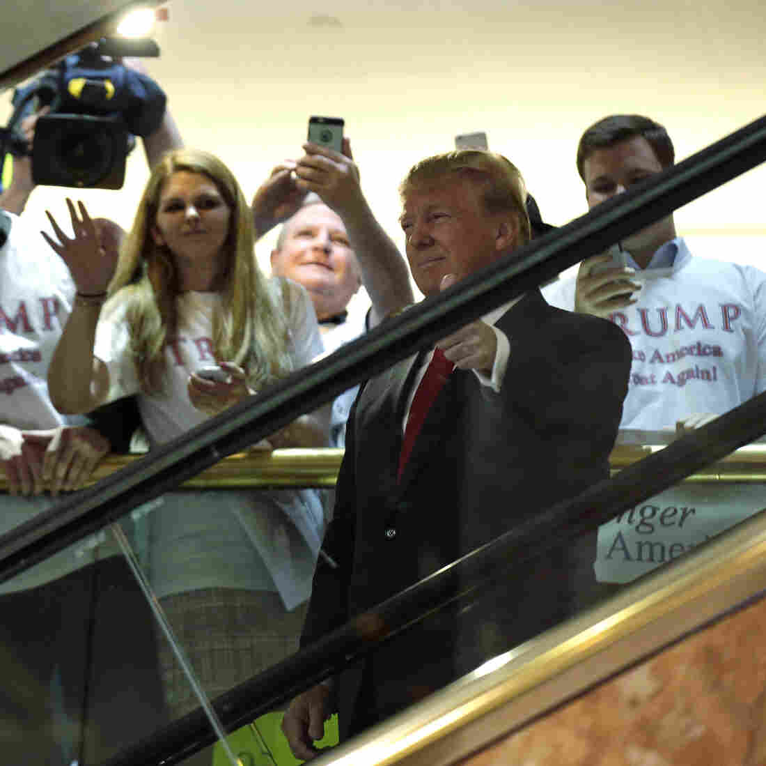 """Republican presidential candidate and TV personality Donald Trump arrives by escalator to the tune of """"Rockin' in the Free World."""" Musician Neil Young did not approve of his song choice."""