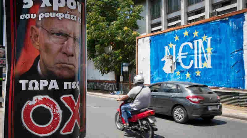 """German Finance Minister Wolfang Schaeuble frowns on a pro-no poster opposite graffiti that reads """"no"""" in German — but also sounds like """"yes"""" in Greek. The photo was taken in Athens on Sunday."""