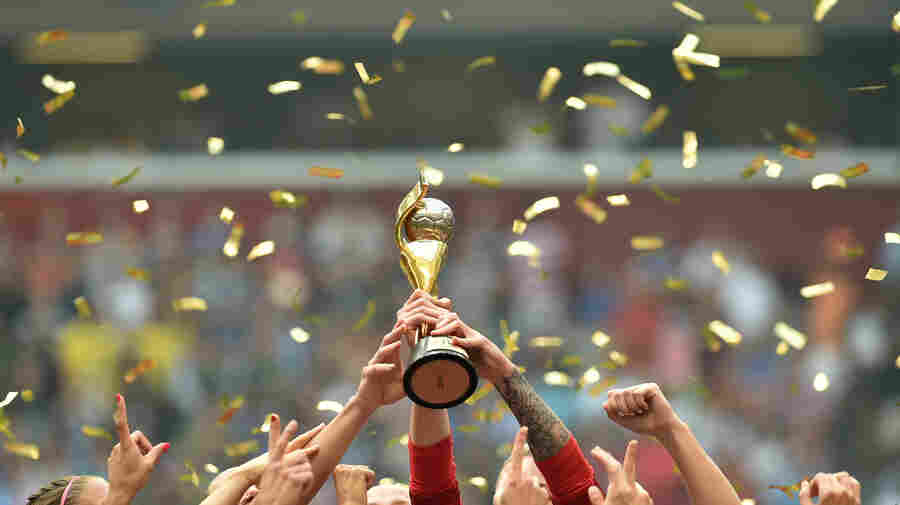 The United States celebrates with the World Cup trophy after their 5-2 win over Japan in the final Sunday night.