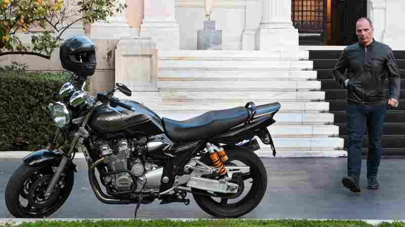 """Greek Finance Minister Yanis Varoufakis walks toward his motorcycle following a meeting with Prime Minister Alexis Tsipras in Athens, Greece, on March 15. Varoufakis said Monday he was resigning, a day after Greeks voted to reject terms of a bailout imposed by Greece's creditors. Varoufakis was one of the leading campaigners behind the """"no"""" vote."""