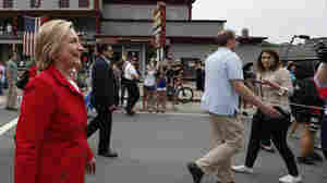 Members of the media are kept behind a moving rope line as Democratic presidential candidate Hillary Clinton marches in a Fourth of July parade in Gorham, N.H.