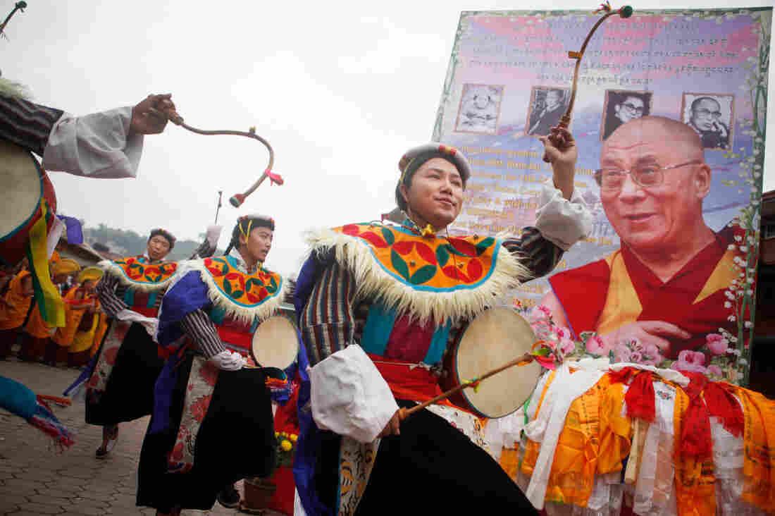 Tibetan men living in Kathmandu, Nepal, danced Monday during celebrations to mark the 80th birthday of the Dalai Lama.