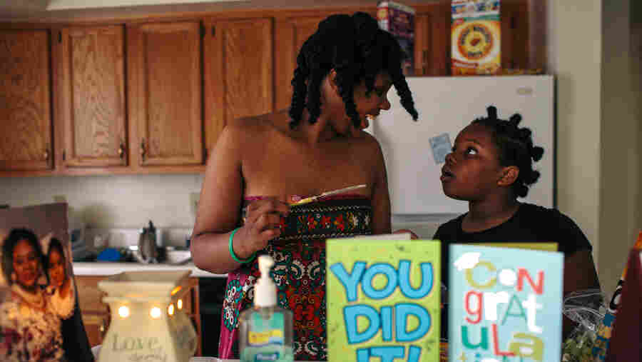Kyra Brooks helps her mother, Jordan McClellan, make lunch in their apartment in Washington, D.C. McClellan has been fighting homelessness for most of her adult life, living in family shelters and transitional housing until she was moved into the rapid rehousing program.