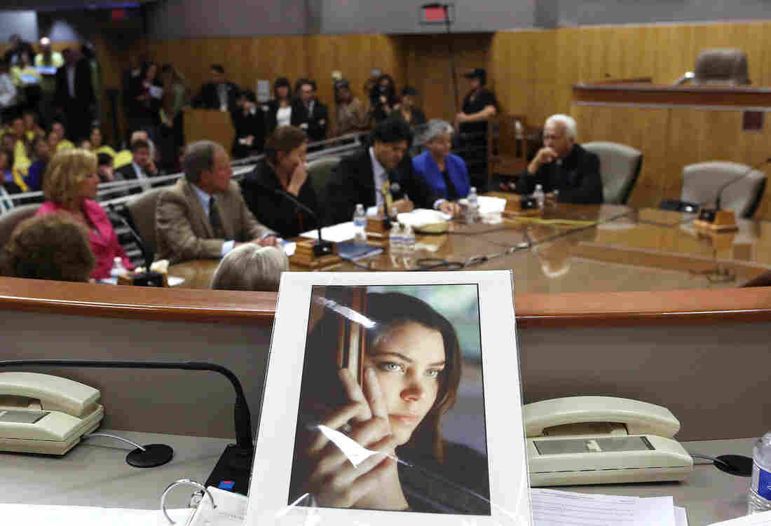 A photo of Brittany Maynard, who moved to Oregon to end her life as she was dying of brain cancer, sits on the dais of the California Senate's health committee in March.