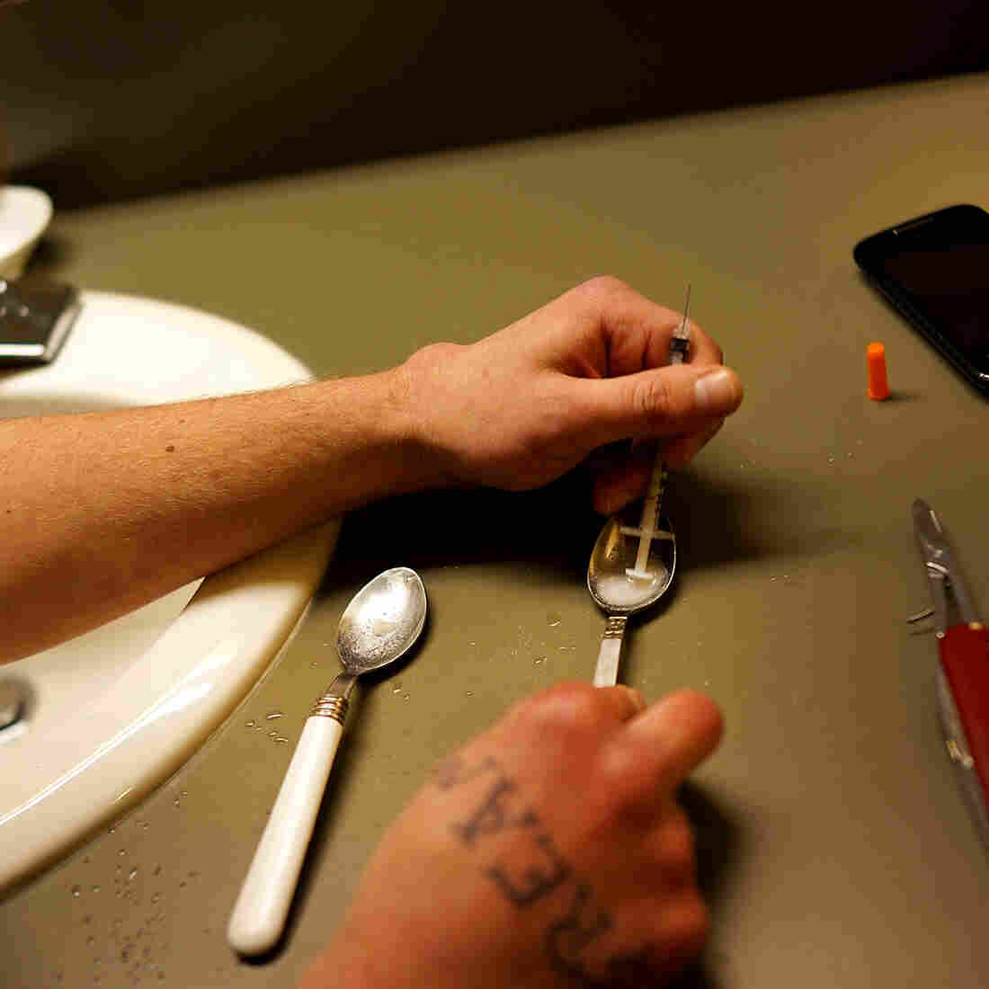 A user prepares drugs for injection in 2014 in St. Johnsbury, Vt.
