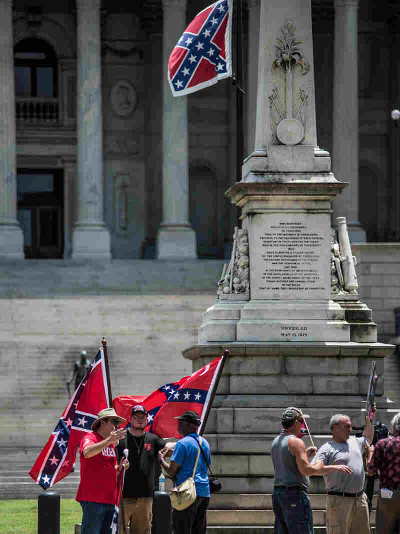 Confederate flag supporters gather at the South Carolina Statehouse in Columbia; the state's Senate voted Tuesday to take down the flag. The issue will now head to the House.