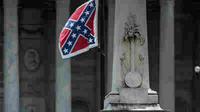 Confederate flag supporters gather at the South Carolina State House in Columbia; the state's Senate voted to take down the flag Tuesday. The issue will now head to the House.