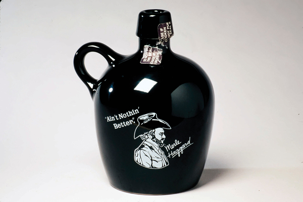 To honor its long-serving brand ambassador, Dickel sold this jug featuring country music star Merle Haggard in the 1970s and early 1980s. From The Art of American Whiskey by Noah Rothbaum.