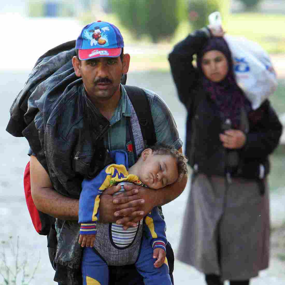 Refugees from Syria arrive in Presevo, near the border with Macedonia, in the south of Serbia, on Wednesday. The U.N. says more than 4 million have fled the civil war in Syria, making it the worst refugee crisis in a quarter century.