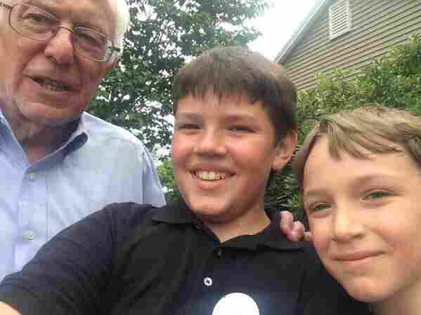 """Miguel, 12, and Eduardo Figueroa, 9, posed with Bernie Sanders at a house party in Bow, N.H. Their mom, Kate Goldman, says, """"We are a family of supporters of Sanders for President now!"""""""