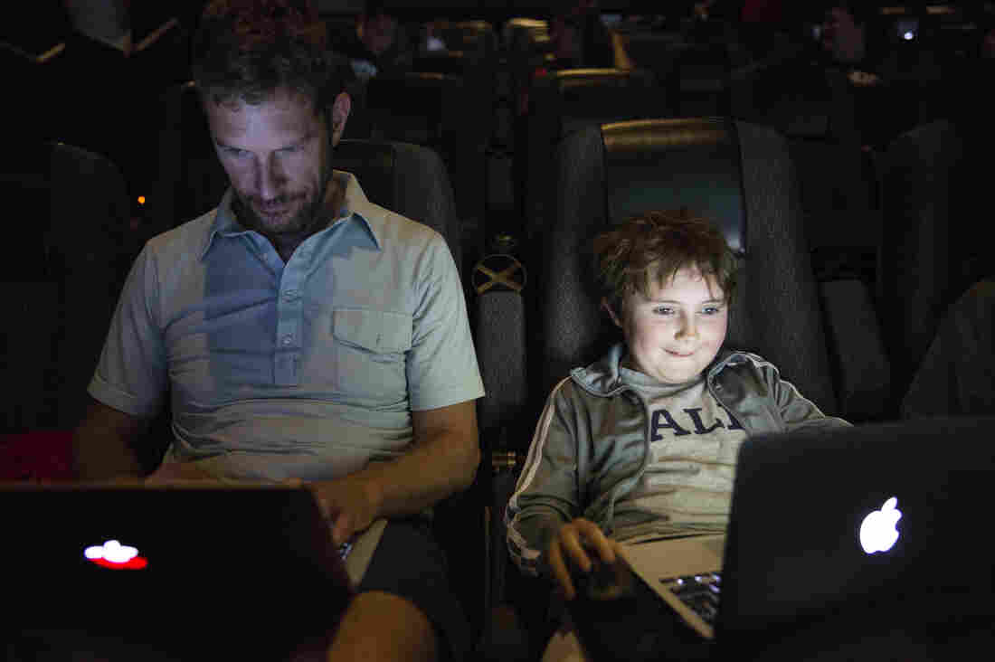 "Jon Ogilvy plays Minecraft with his son, Nathaniel, 9. Jon said he hasn't played the game in awhile. ""I'm a little rusty,"" Jon said. ""He's a noob,"" Nathaniel responded."