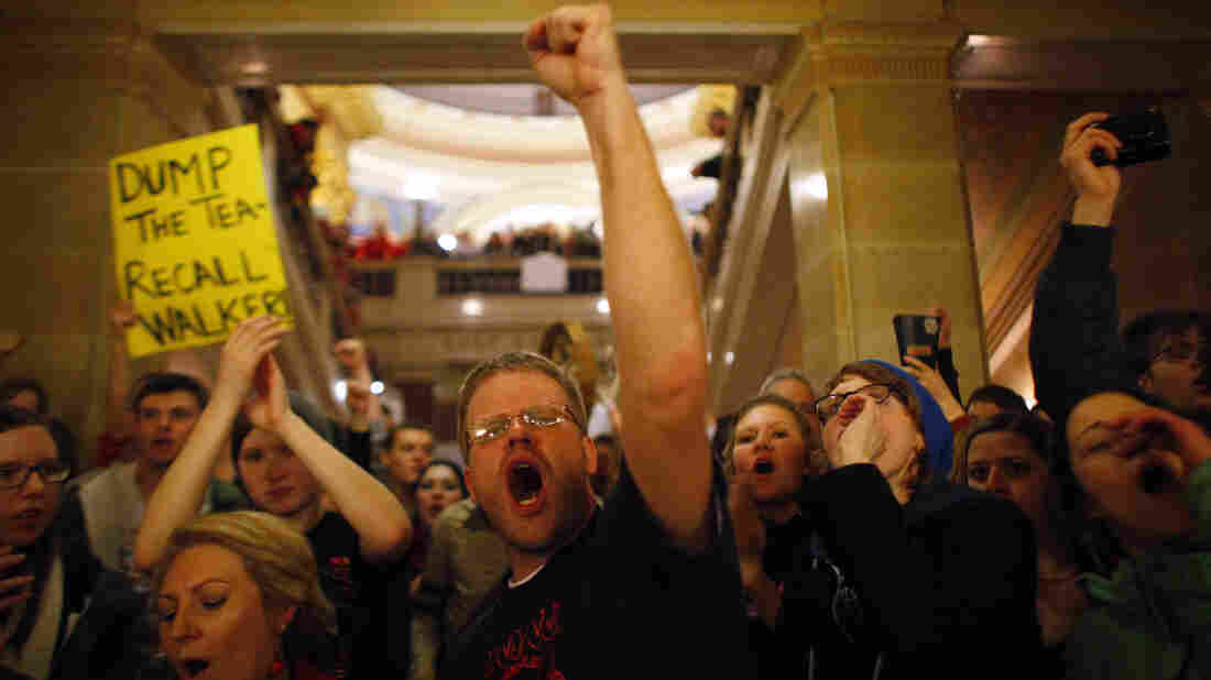 Protesters react to an appearance by Walker at the Wisconsin State Capitol in 2011.