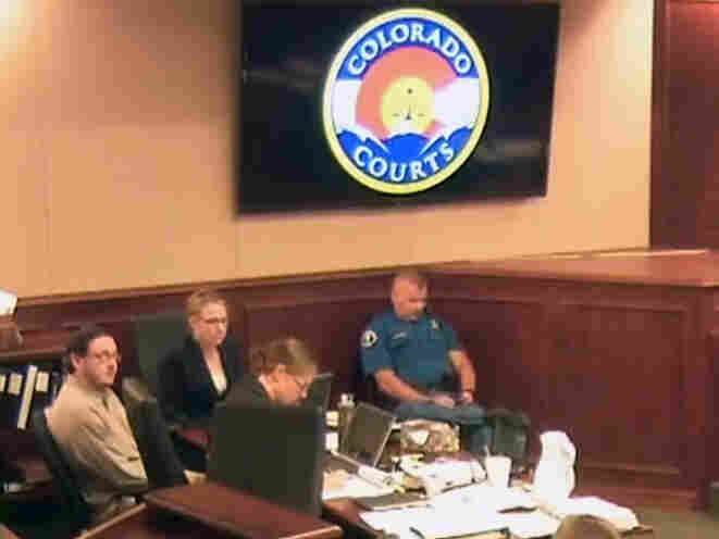 In this image taken from video, Colorado theater shooting suspect James Holmes (left) waits for testimony to resume on July 6 during his trial in Centennial, Colo.