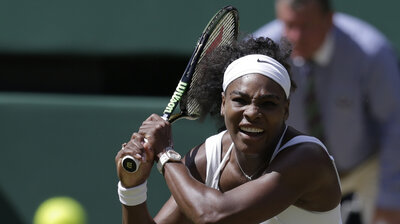 Serena Williams returns a shot to Garbine Muguruza of Spain during the women's singles final at the All England Lawn Tennis Championships in Wimbledon, London, on Saturday.