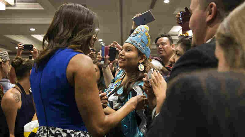 Obama embraces Deandra Antonio, 17, of Whiteriver, Ariz., after her speech.