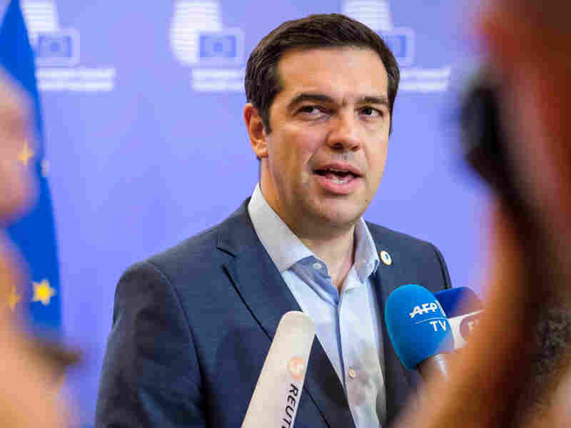 Greek Prime Minister Alexis Tsipras speaks with reporters after meeting with eurozone leaders in Brussels on Monday. The leaders reached a tentative agreement on a bailout program that provides cash in exchange for changes in the way the Greek government operates.