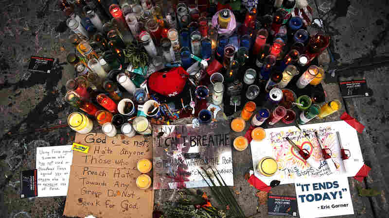 A memorial for Eric Garner, seen July 22, 2014, lies near where he died in Staten Island, N.Y. Just a few days ahead of the anniversary of his death, Garner's family has reached a settlement with New York City.