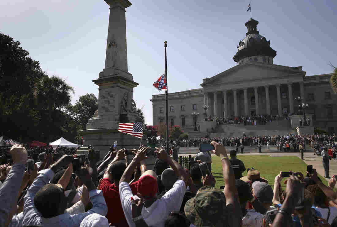 A crowd cheers as the Confederate flag is lowered from the Statehouse grounds on July 10 in Columbia, S.C. Republican Gov. Nikki Haley presided over the event after signing the historic legislation the day before.