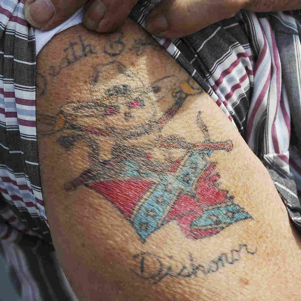 A man displays a Confederate flag tattoo as he participates in a rally to show support for the American and Confederate flags on July 11 in Loxahatchee, Fla. Organizers of the rally said that after the Confederate flag was removed from South Carolina's Statehouse, it reinforced their need to show support for the Confederate flag, which some feel is under attack.