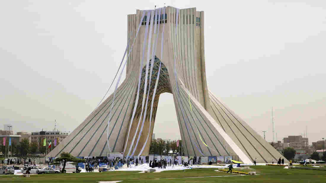 """Iranian hard-liners hang petitions from the Azadi (Freedom) Tower in Tehran during a June 30 demonstration demanding a """"good deal"""" in the nuclear negotiations between Iran and six world powers. Negotiators announced a deal Tuesday morning in Vienna."""