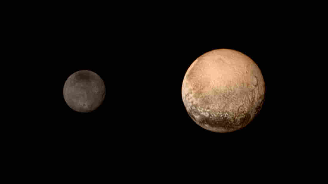 A portrait of Pluto (right) and its moon Charon in a colorized, composite image made July 11 during the final approach of the New Horizons spacecraft. Astronomers are eager to get a much closer view of the icy world Tuesday.