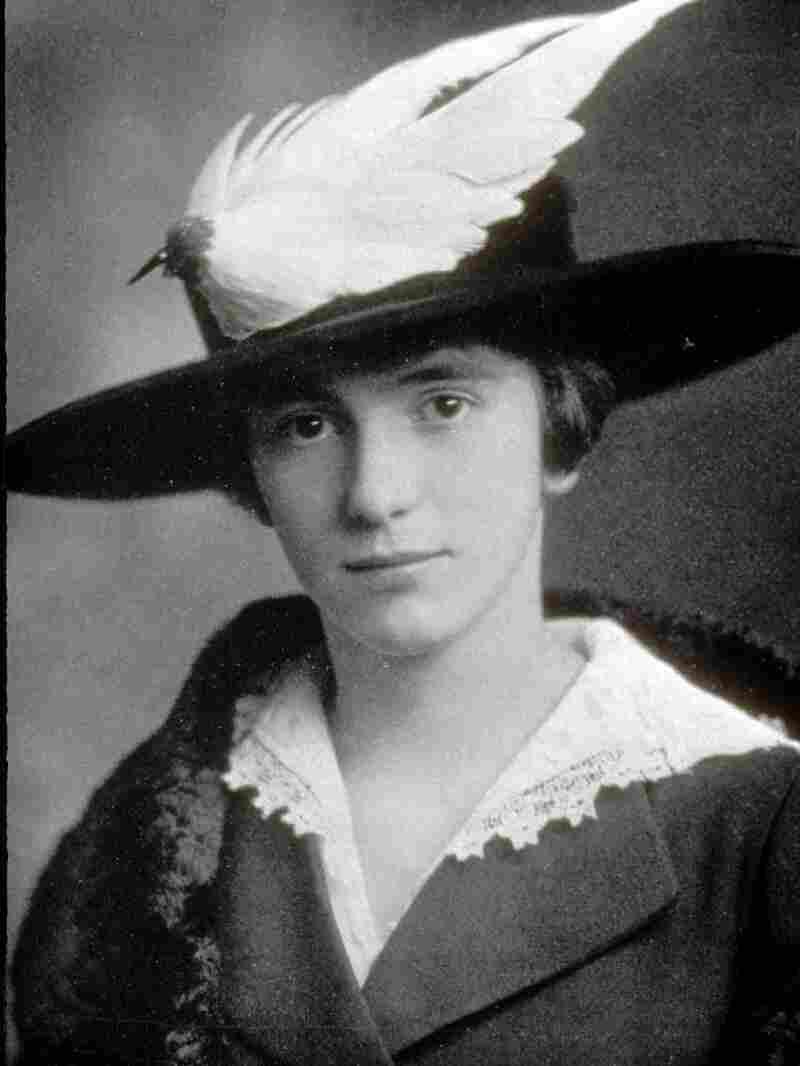 Woman in a bird hat.