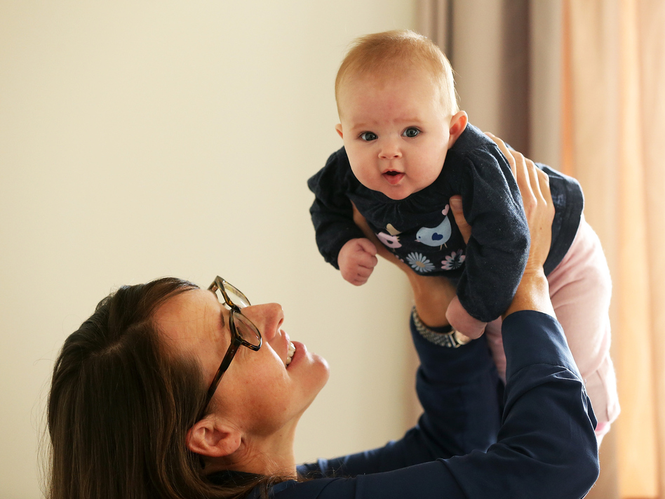 Secondary school teacher Sarah Ward at home on maternity leave with her 3-month-old daughter, Esme Kelliher. A resident of New Zealand, Ward has access to paid leave, something many American mothers do not. (Fiona Goodall/Getty Images)