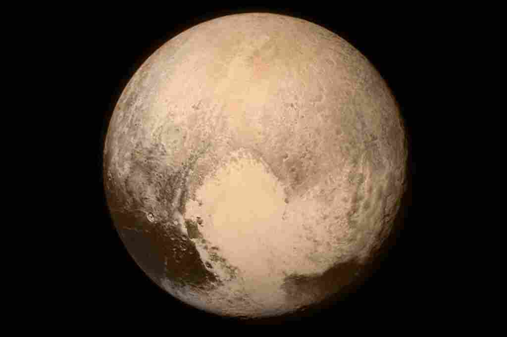 """An image of Pluto that was taken by New Horizons shortly before its flyby Tuesday shows a heart-shaped pattern on the planet's surface. NASA says Pluto """"sent a love note back to Earth."""""""