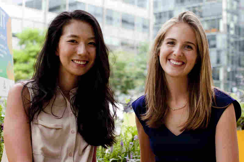 Claire Kang (left) and Laura Carey were inspired by Golden Triangle's yellow, triangular logo when designing the parklet on K Street Northwest.