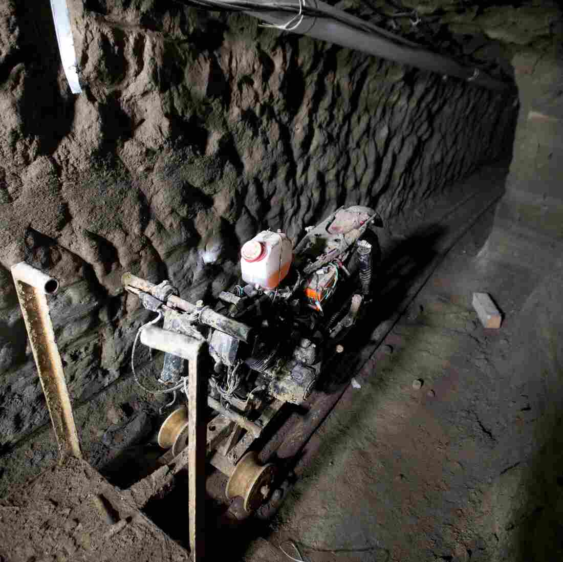 "A motorcycle adapted to a rail sits in the tunnel under the house where, according to authorities, drug lord Joaquín ""El Chapo"" Guzmán made his escape from the Altiplano maximum-security prison."