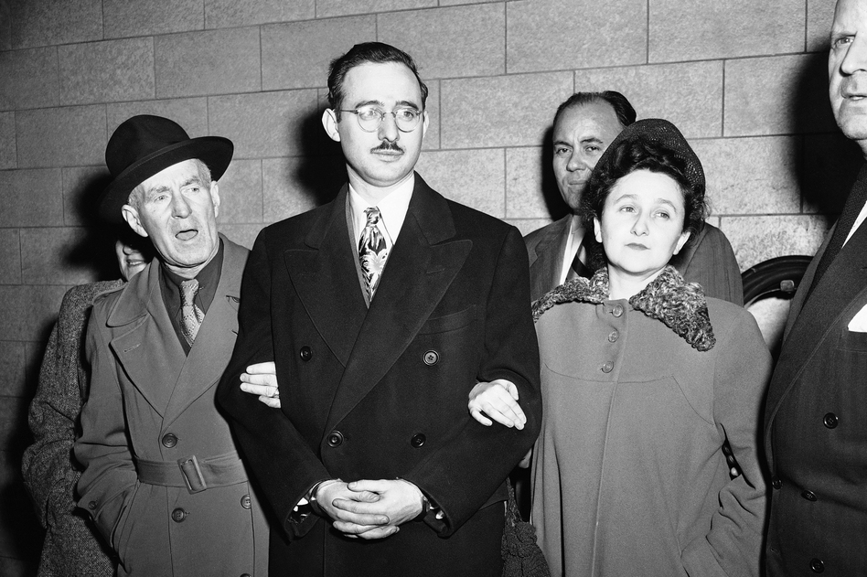 Harry McCabe (from left), deputy U.S. marshal; Julius Rosenberg and his wife, Ethel; Anthony H. Pavone, deputy U.S. marshal, in New York on March 8, 1951. (AP)